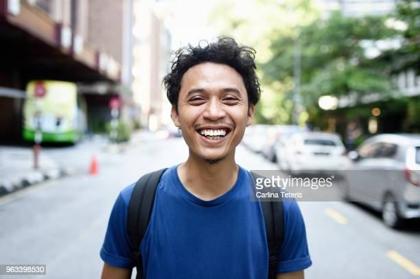 Portrait of a young Malay man on the street