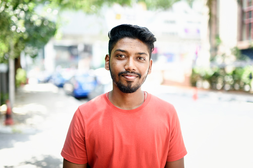 Portrait of a young Malaysian Indian man on the street - gettyimageskorea