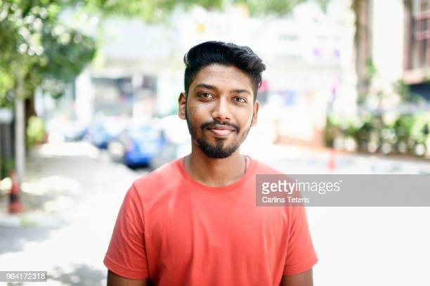 portrait of a young malaysian indian man on the street - indian subcontinent ethnicity stock pictures, royalty-free photos & images