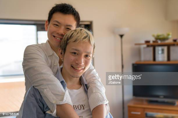 Portrait of a young male couple at home