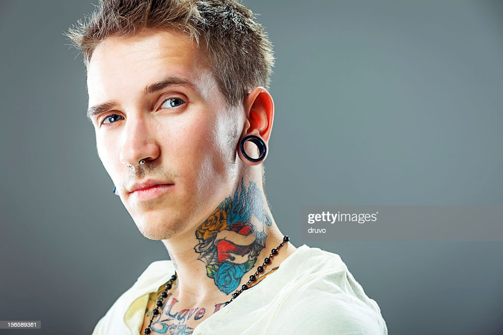 Portrait of a young male with tattoos : Stock Photo
