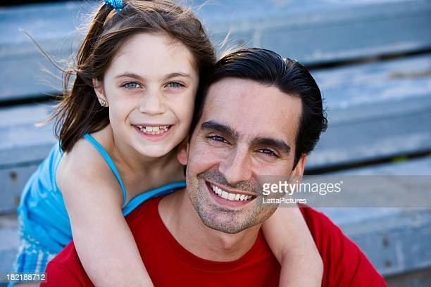 Portrait of a young man and elementary age girl