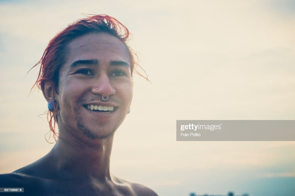 A portrait of a young man at the beach. : Stock Photo