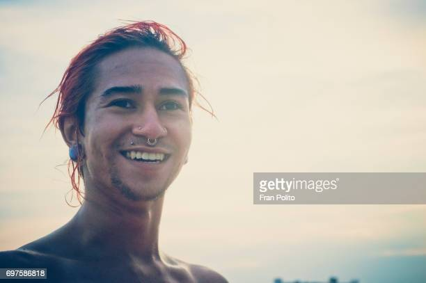 A portrait of a young man at the beach.