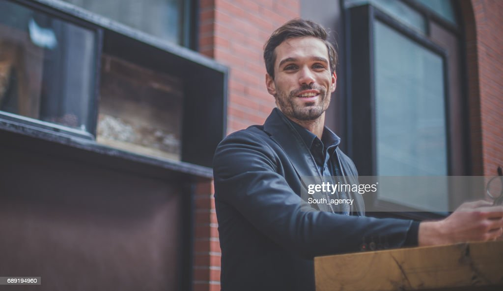 Portrait of a young man at the sidewalk cafe : Stock Photo