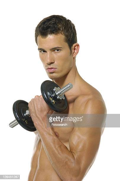 Portrait of a young man exercising with a hand weight
