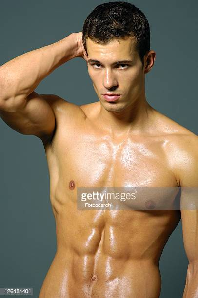 Portrait of a young man flexing his biceps