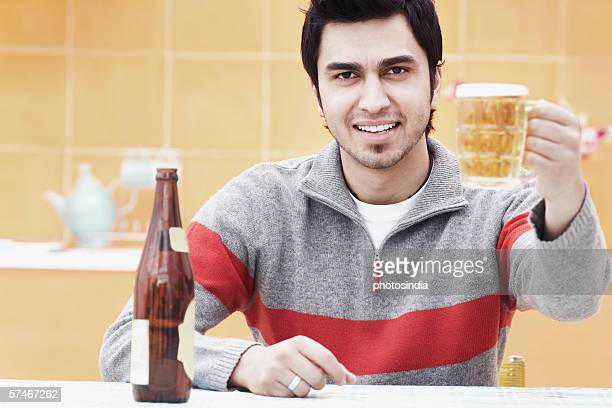 Portrait of a young man holding a beer stein