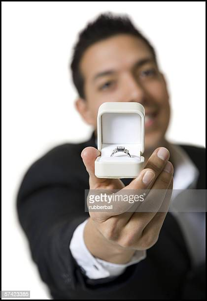 Portrait of a young man holding a jewelry box