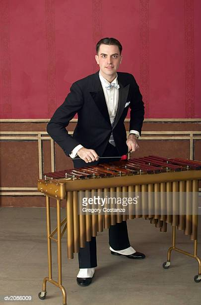 Portrait of a Young Man in an Old-Fashioned Suit Playing the Xylophone