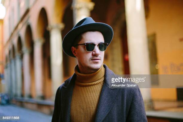 portrait of a young man in hat and sunglasses - a fall from grace stock pictures, royalty-free photos & images