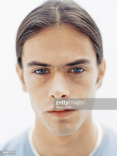 portrait of a young man looking sad