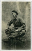Portrait of a young man on a childs tricycle circa 1920s picture id481609341?s=170x170