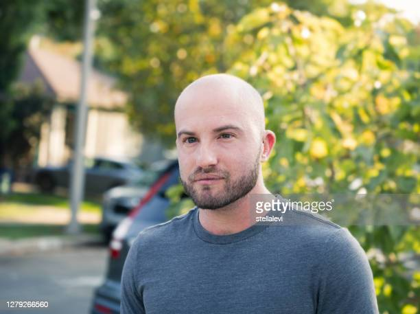 portrait of a young man on the street - stellalevi stock pictures, royalty-free photos & images
