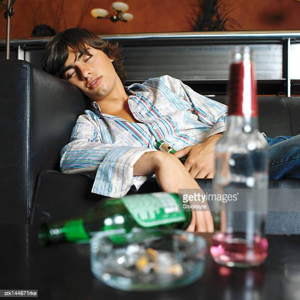 portrait of a young man passed out on the couch