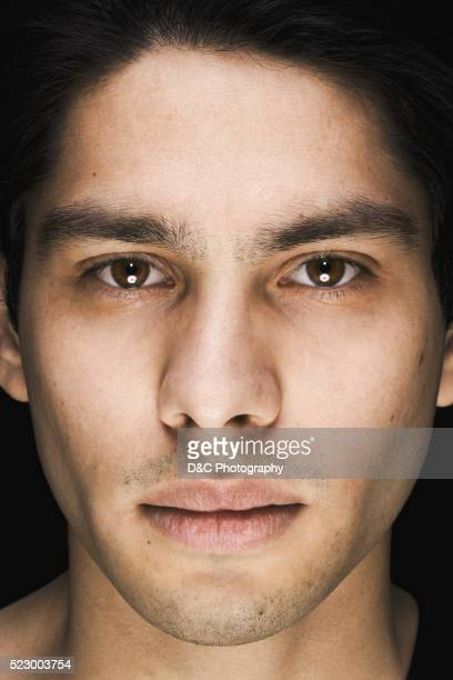 portrait of a young man - 黒っぽい目 ストックフォトと画像