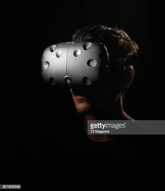 Portrait of a young man playing a game with an HTC Vive virtual reality headset taken on September 2 2016