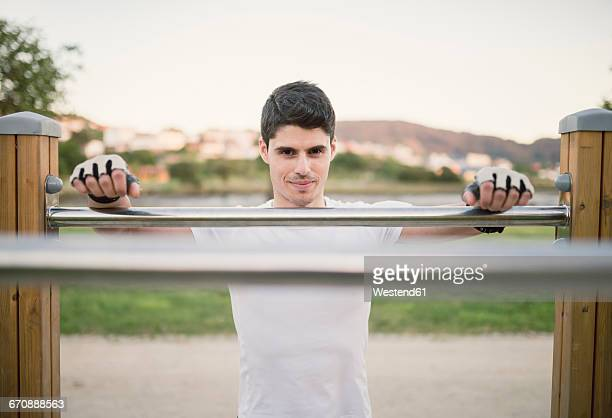 Portrait of a young man, ready to train on metall bars