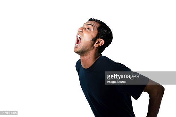 Portrait of a young man shouting