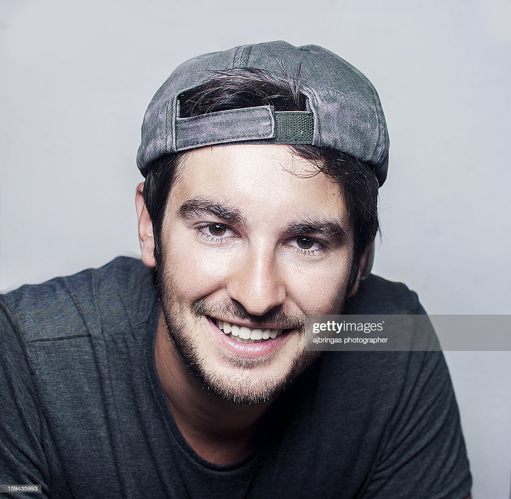 Portrait of a young man smiling. : Stock Photo