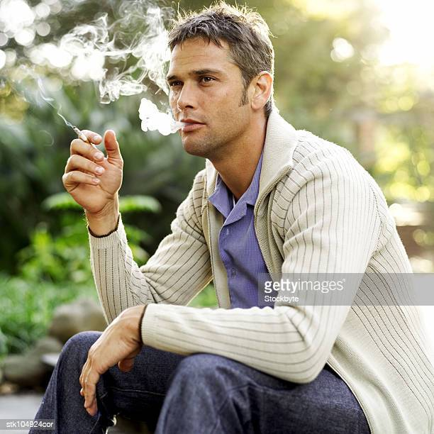 portrait of a young man smoking a cigarette
