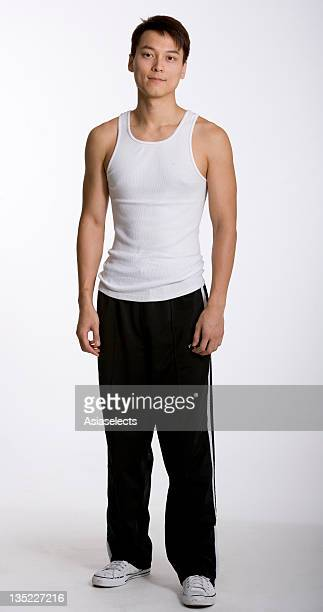 portrait of a young man standing - vest stock pictures, royalty-free photos & images