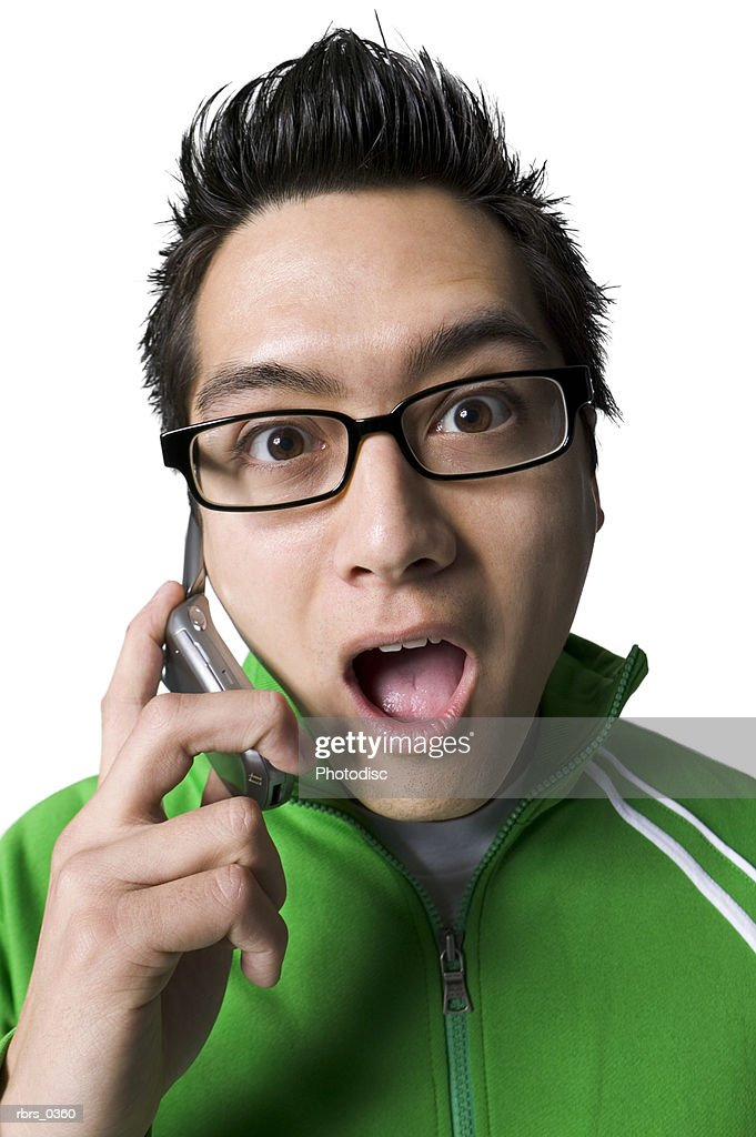 Portrait of a young man talking on a mobile phone : Foto de stock