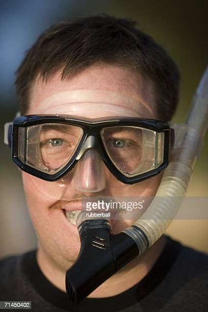 Portrait of a young man wearing a snorkel