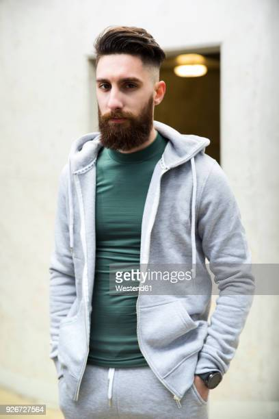 Portrait of a young man wearing a track suit