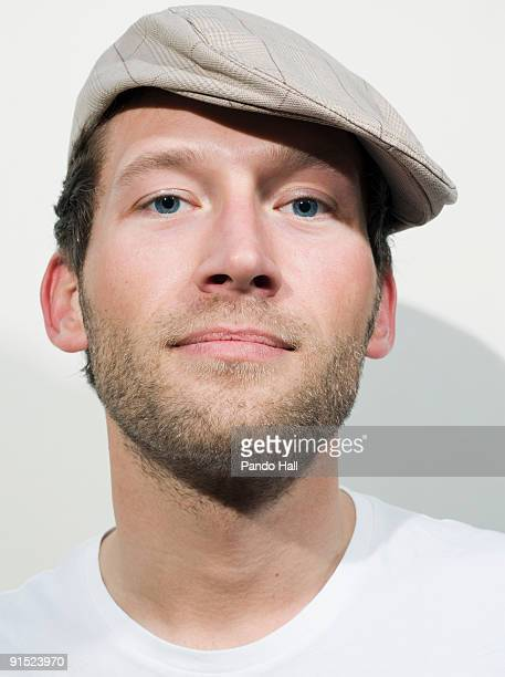portrait of a young man wearing hat, close-up - flat cap stock pictures, royalty-free photos & images