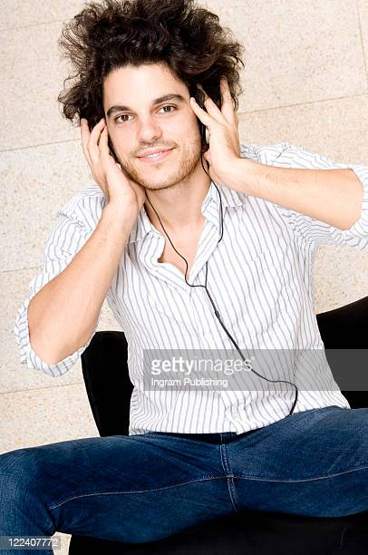 portrait of a young man wearing headphones - jean ingram stock pictures, royalty-free photos & images