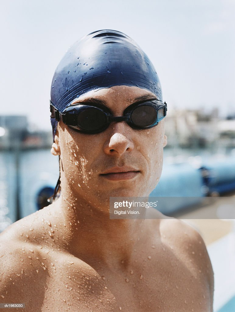 Portrait of a Young Man Wearing Swimming Goggles and Cap : Stock Photo