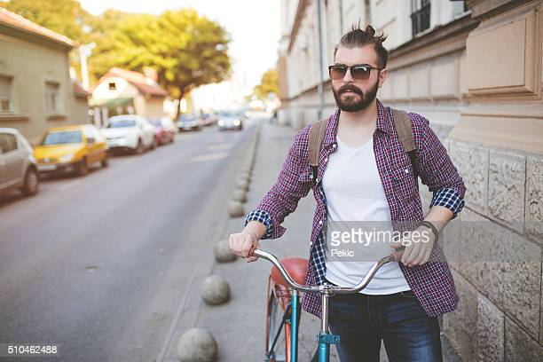portrait of a young man with a bicycle - checked shirt stock photos and pictures
