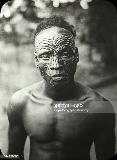 Portrait of a young man with facial scars Original caption 'Native showing scarification of face' There is no official date for this image although...