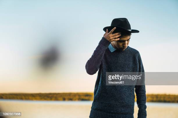 portrait of a young man with hat at  a lake - norrbotten province stock pictures, royalty-free photos & images