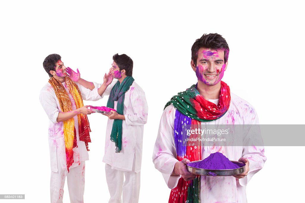 Portrait of a young man with holi colour : Stock Photo