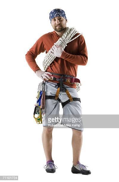 portrait of a young man with rock-climbing gear - rock object photos et images de collection
