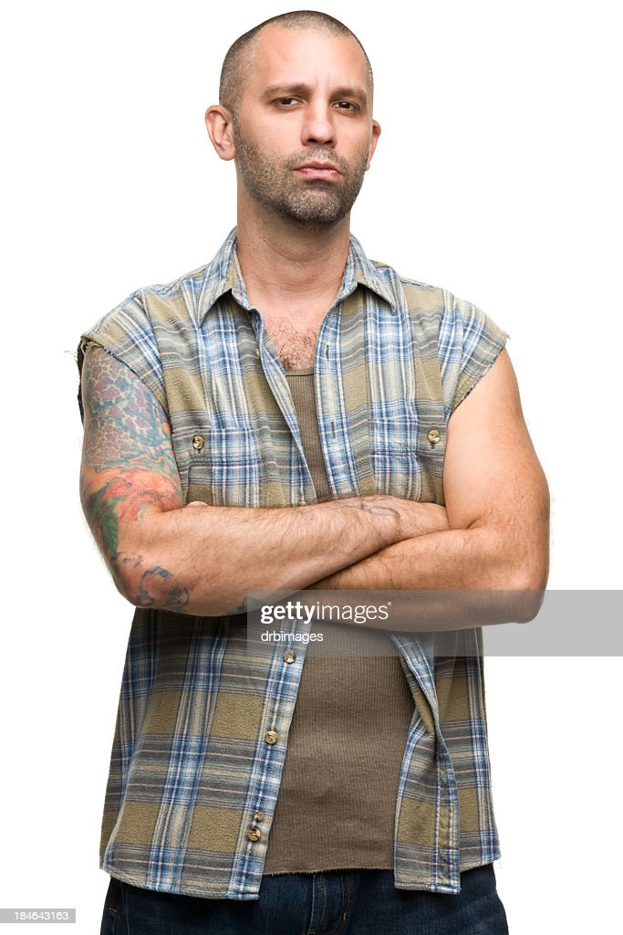 Portrait of a young man with tattoos in a checkered shirt : Stock Photo