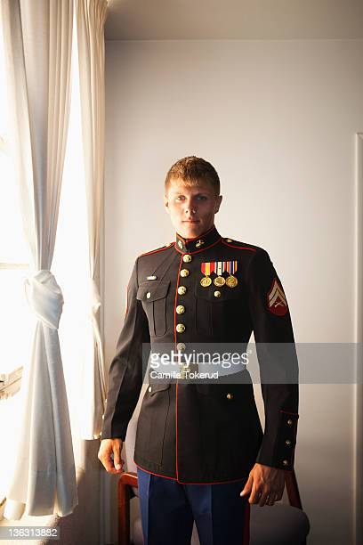 Portrait of a young Marine by the window
