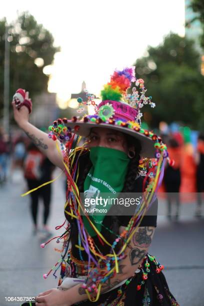 Portrait of a young member of the dance group that accompanied the march against violence in Santiago of Chile on 22 November 2018 in support of the...