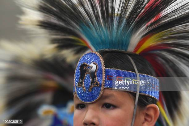 A portrait of a young member of the First Nations during the third annual traditional Pow Wow competition at the KDays Festival in Edmonton Over 700...