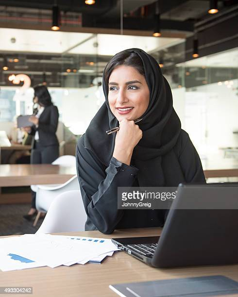 portrait of a young middle eastern businesswoman at work - looking away stock pictures, royalty-free photos & images