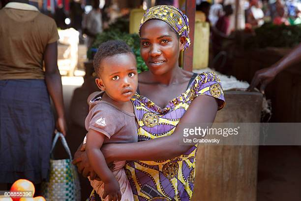 Portrait of a young mother with her son in a market hall on August 11 2016 in Kigali Rwanda