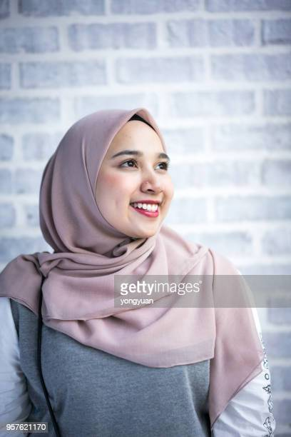portrait of a young muslim woman wearing a hijab - malay hijab stock photos and pictures
