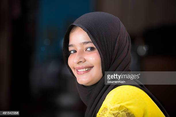 Portrait of a young Muslim woman with traditional headscarf
