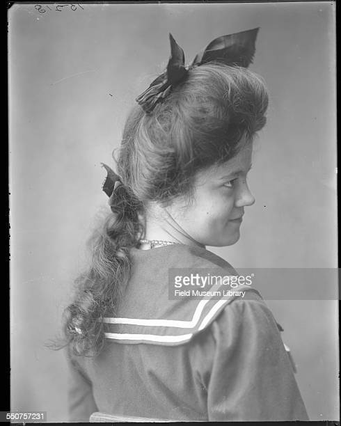 Portrait of a young Native American Cherokee woman, Mary Selby, aged 18 years, wearing a sailor suit type dress with bows on dress and in her hair at...