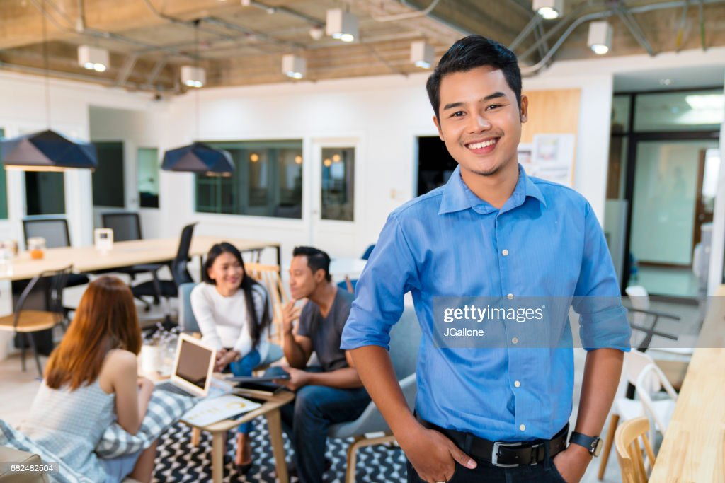 Portrait of a young office worker : Stock Photo