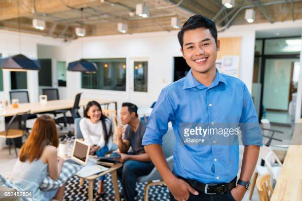 portrait of a young office worker - asian and indian ethnicities stock pictures, royalty-free photos & images