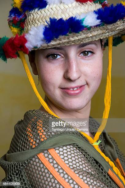 Portrait of a young pretty Morocan woman with a traditional hat, Fes,Fès-Boulemane, Morocco. Young people in Morocco make up 30 percent of the...