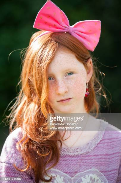 portrait of a young redheaded girl dressed up for valentines day - hair bow stock pictures, royalty-free photos & images